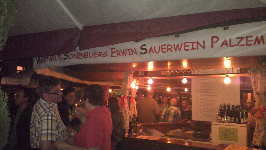 "The most popular stand on a wine festival: Called ""sour wine"" and written in Comic Sans"